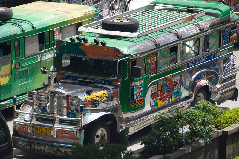 Jeepneys with spare tire on the roof - Baguio, Philippines