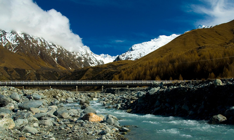Bridge over alpine river on the road to mount Cook