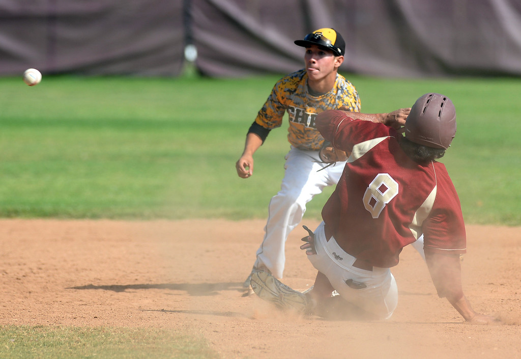 . La Serna\'s Tony Ceron (#8) steals second base as they play Santa Fe in their Del Rio League game at La Serna High School in Whittier on Wednesday April 23, 2014. (Staff Photo by Keith Durflinger/Whittier Daily News)