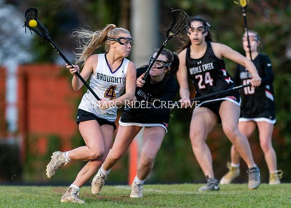Broughton girls varsity lacrosse vs Middle Creek. February 28, 2020. D4S_0682