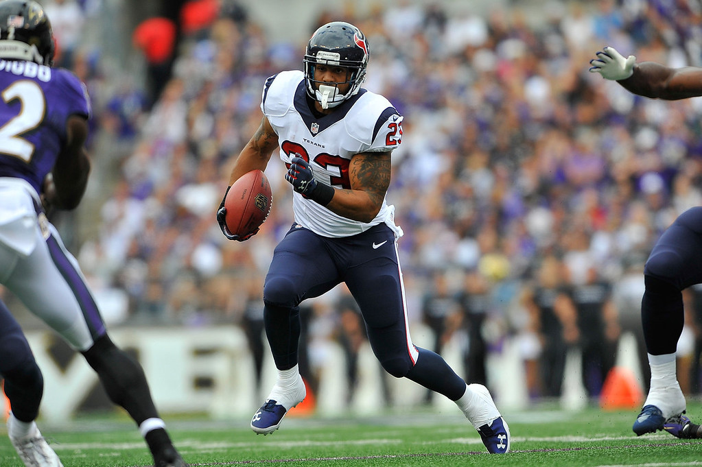 . Running back Arian Foster #23 of the Houston Texans runs the bal against the Baltimore Ravens at M&T Bank Stadium on September 22, 2013 in Baltimore, Maryland.  (Photo by Larry French/Getty Images)