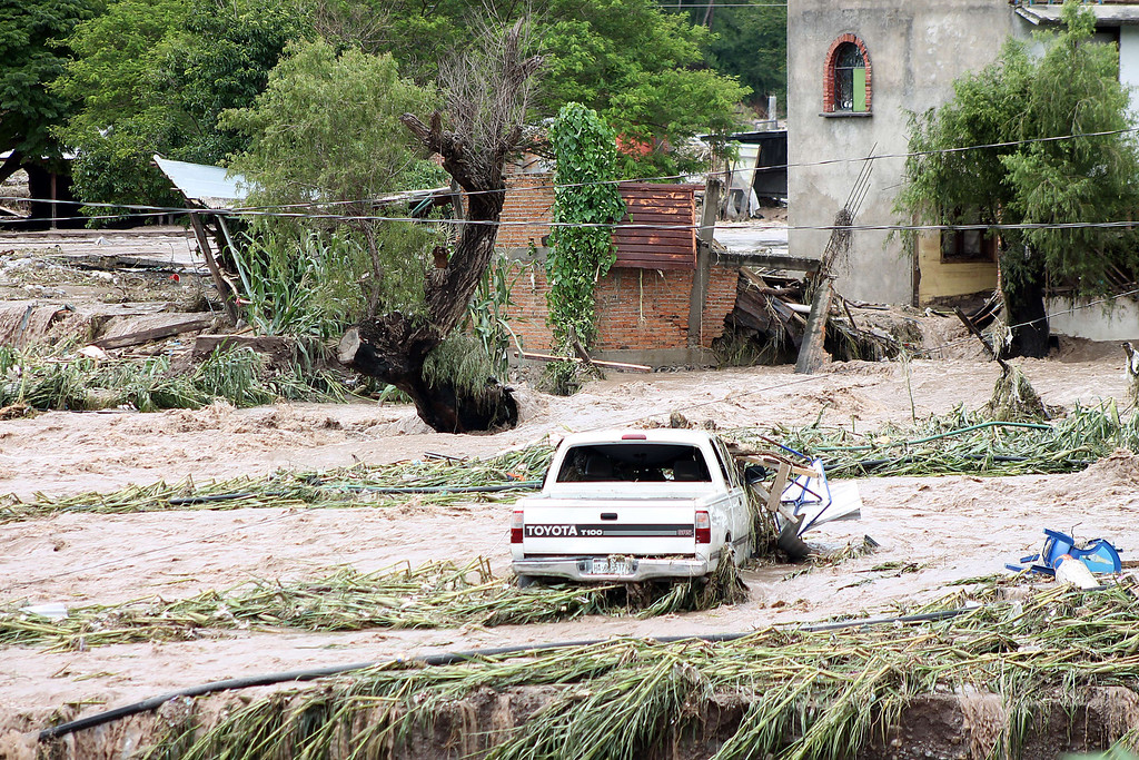 . View of a flooded area in Chilpancingo, state of Guerrero, Mexico, on September 17, 2013. Mexican authorities scrambled Tuesday to launch an air lift to evacuate tens of thousands of tourists stranded amid floods in the resort of Acapulco following a pair of deadly storms. The official death toll rose to 47 after the tropical storms, Ingrid and Manuel, swarmed large swaths of the country during a three-day holiday weekend, sparking landslides and causing rivers to overflow in several states. EDUARDO GUERRERO/AFP/Getty Images