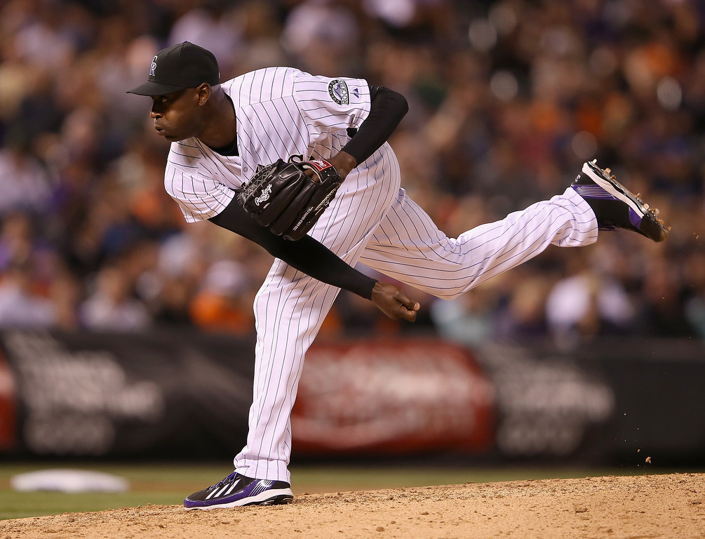 . Relief pitcher LaTroy Hawkins #32 of the Colorado Rockies delivers against the San Francisco Giants at Coors Field on April 22, 2014 in Denver, Colorado. Hawkins earned a save as the Rockies defeated the Giants 2-1.  (Photo by Doug Pensinger/Getty Images)