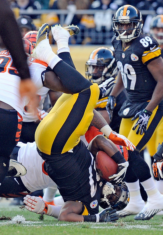 . Pittsburgh Steelers running back Jonathan Dwyer (27) flips over as he is tackled on a run in the second quarter of an NFL football game against the Cincinnati Bengals on Sunday, Dec. 23, 2012, in Pittsburgh. (AP Photo/Don Wright)