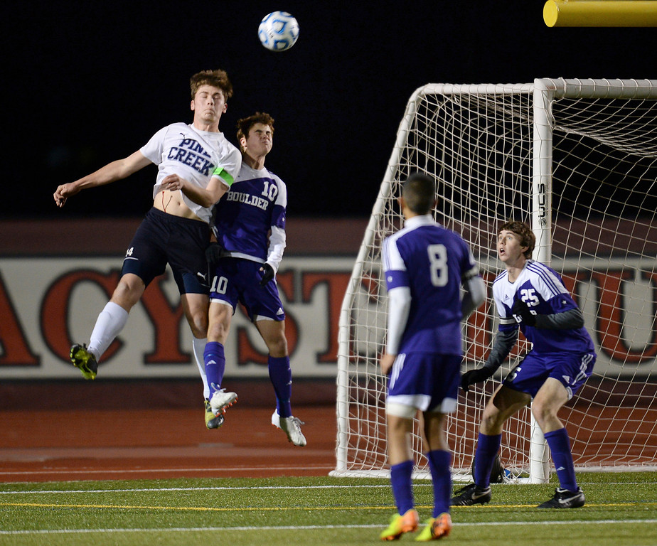 . From left, Nicol Farley of Pine Creek High School (14) heads the ball over Quinn Liebmann of Boulder High School (10) and past Javier Castruita (8) and Ryan Bower (25) of Boulder High School in the second half. (Photo by Hyoung Chang/The Denver Post)
