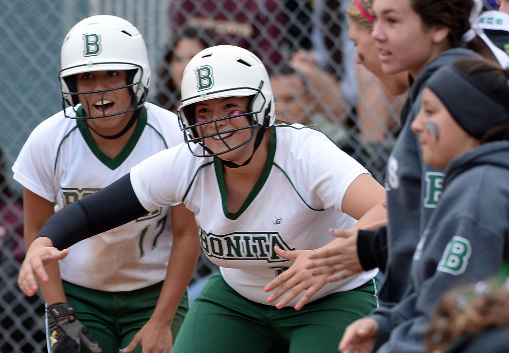 . Bonita teammates wait for Chloe Melanson (not pictured) at home plate after hitting a two run home run in the sixth inning of a prep softball game against West Covina at Los Flores Park in La Verne, Calif., on Thursday, March 27, 2014. Bonita won 6-3. (Keith Birmingham Pasadena Star-News)