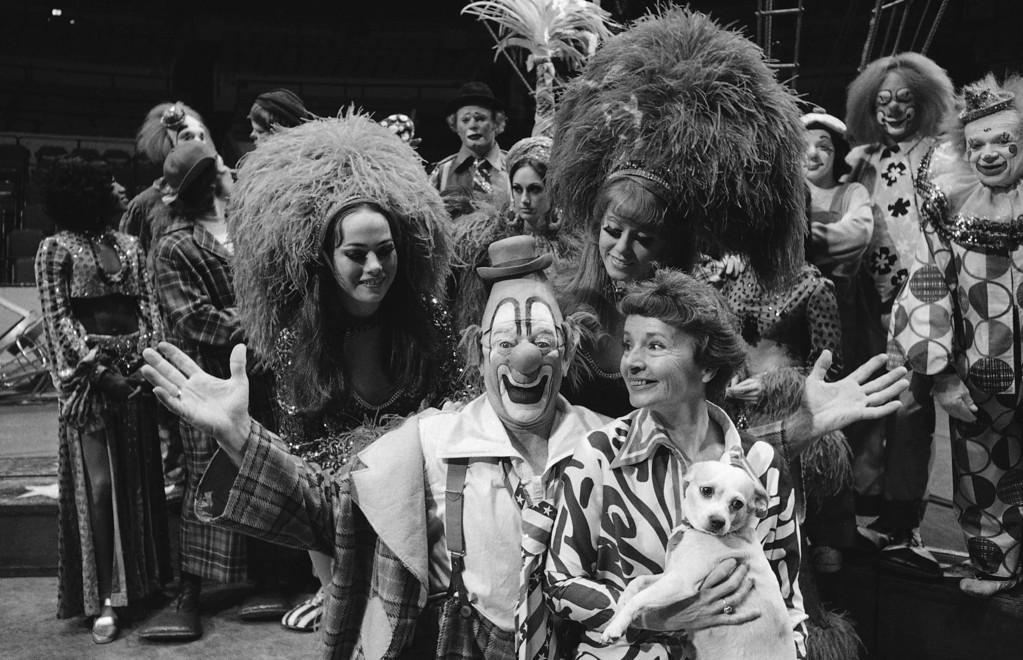. Lou Jacobs, center, whose face has appeared on Ringling Brothers and Barnum and Bailey circus posters for the past 30 years, poses with his wife Jean, holding his dog Knucklehead, and daughters Dolly and Lou Anne, left and right, both circus show girls, before the circus� performance, May 16, 1973. Jacobs, who had has been making smiles in the circus for 50 years is also celebrating his 70th birthday at the main arena of Madison Square Garden in New York. Dolly Jacobs is 16, Lou Anne, 18. (AP Photo/Anthony Camerano)