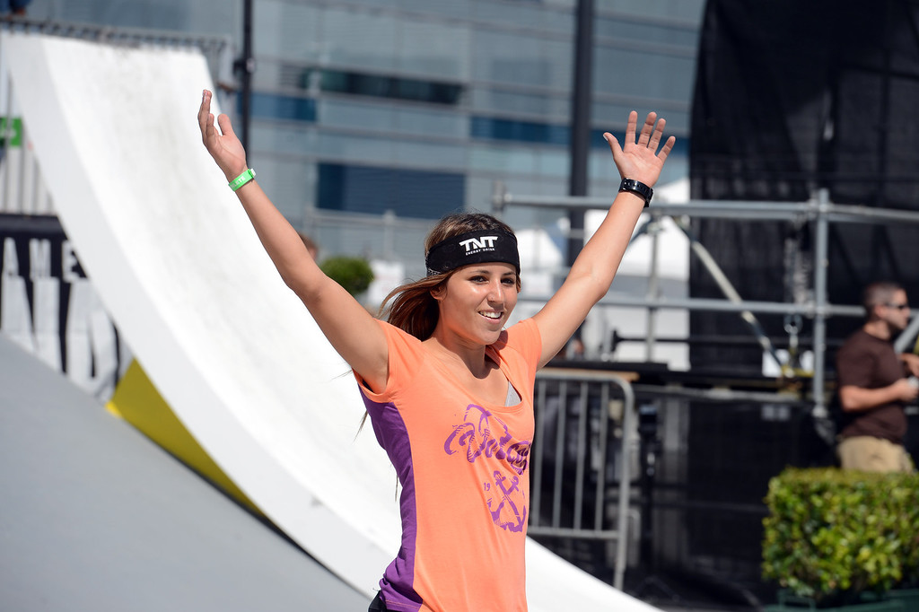 . Leticia Bufoni celebrates her gold medal during the  X Games Los Angeles Women\'s Skateboard Street Final at LA Live Thursday, August 1, 2013. (Hans Gutknecht/Los Angeles Daily News)
