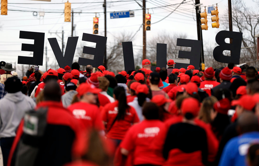 ". A group carries letters spelling ""BELIEVE\"" as they take part in a march honoring Martin Luther King Jr., Monday, Jan. 21, 2013, in San Antonio. (AP Photo/Eric Gay)"