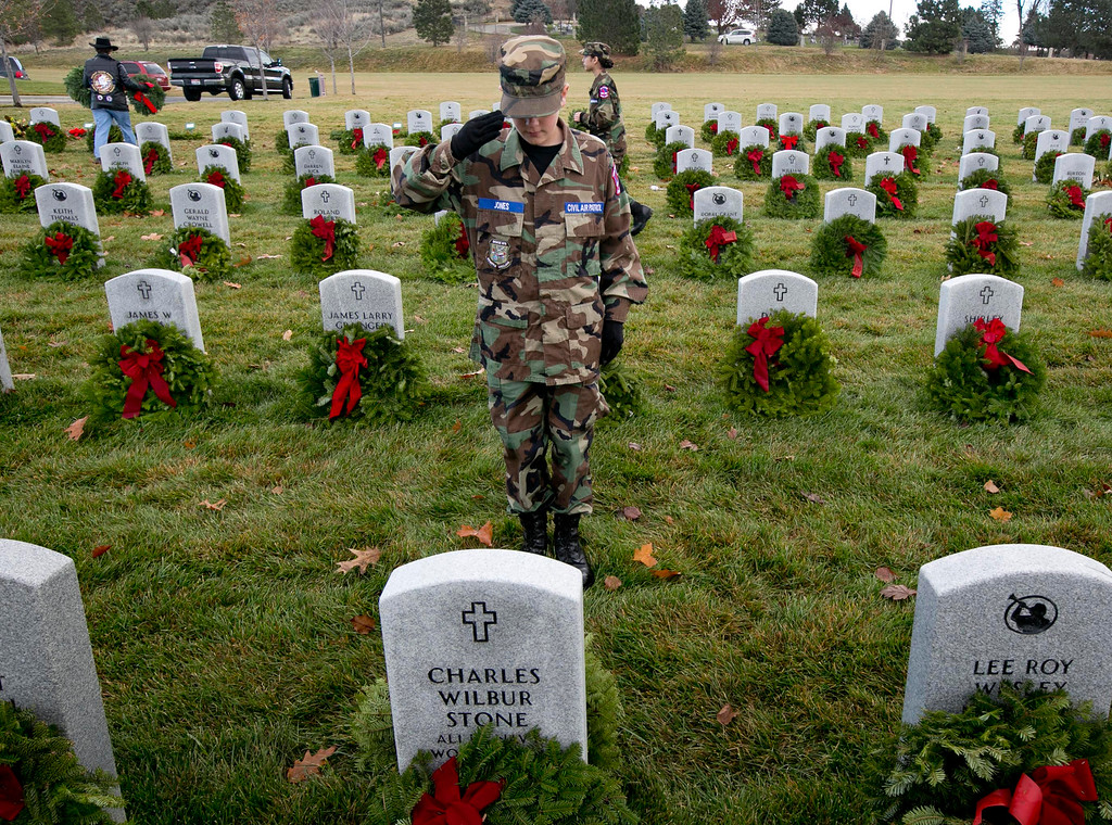 . Connor Jones, 12, with the Boise Civil Air Patrol, salutes after laying a wreath at a veteran\'s gravestone Saturday, Dec. 13, 2014, at the Idaho State Veterans Cemetery in Boise, Idaho. The Boise Civil Air Patrol and a small army of volunteers laid 3,100 wreaths following a ceremony as a part of the nationwide event Wreaths Across America. (AP Photo/The Idaho Statesman, Darin Oswald)