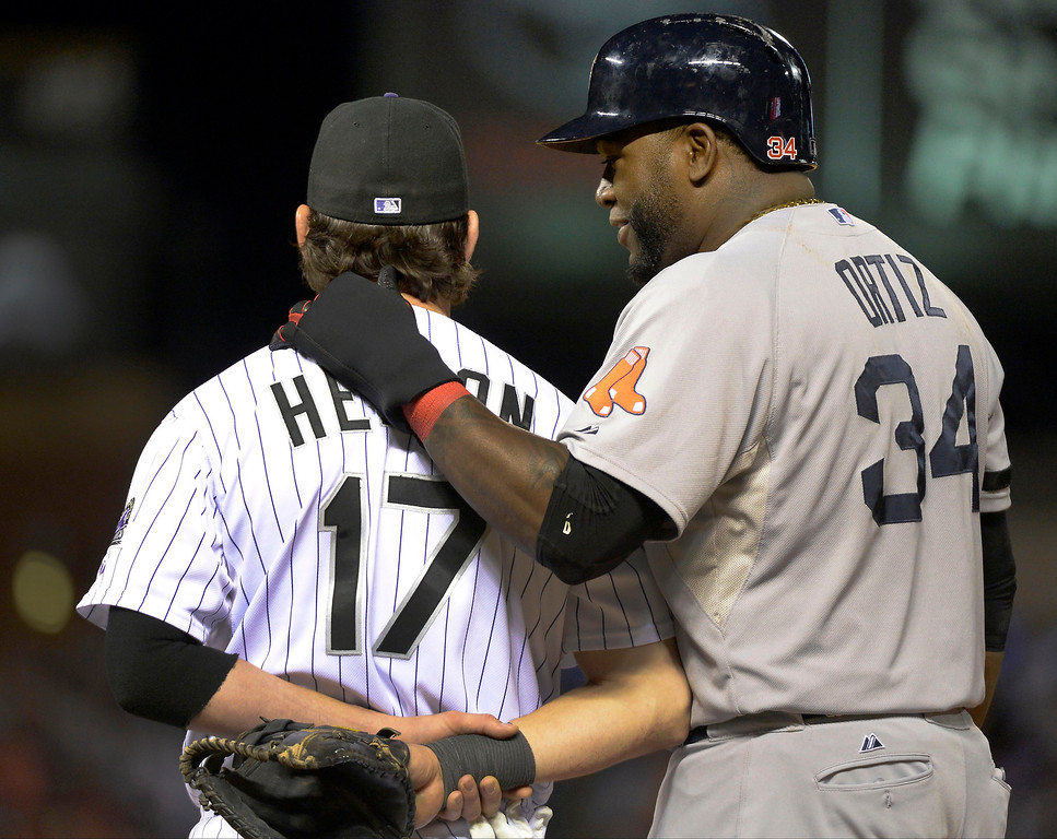 . David Ortiz (34) of the Boston Red Sox puts his arm on Todd Helton (17) of the Colorado Rockies back as he stands on base in the 4th inning September 25, 2013 at Coors Field. Helton will retire at the end of the season after 17 years with the club.  (Photo By John Leyba/The Denver Post)