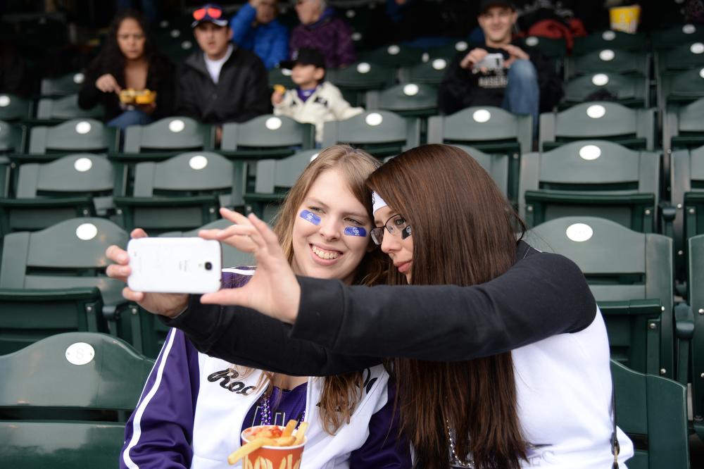 . Danielle Fisch and Brittney Salisbury from Cheyanne, Wyo. shoot a selfie before the game. The Colorado Rockies hosted the Arizona Diamondbacks in the Rockies season home opener at Coors Field in Denver, Colorado Friday, April 4, 2014. (Photo by Hyoung Chang/The Denver Post)