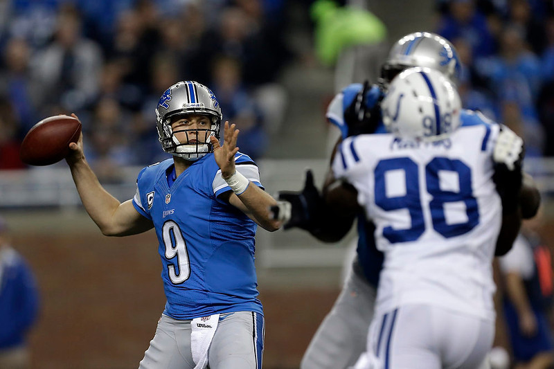 . Detroit Lions quarterback Matthew Stafford (9) throws as Indianapolis Colts linebacker Robert Mathis (98) applies pressure in the first quarter of an NFL football game in Detroit, Sunday, Nov. 2, 2012. (AP Photo/Paul Sancya)