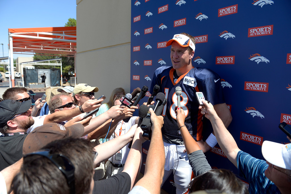 . Denver Broncos quarterback Peyton Manning (18) talks to the media after practice August 20, 2013 at Dove Valley (Photo by John Leyba/The Denver Post)