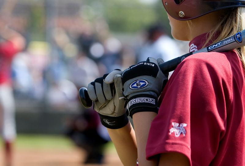 the hands of a batter in the on-deck circle.