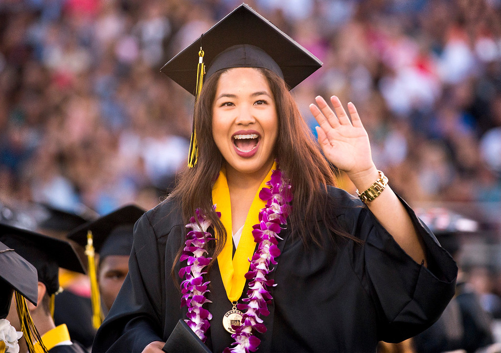 . Connie Nguyen waves to family in the stands during Northview High graduation commencement at Covina District Field June 11, 2014.   (Staff photo by Leo Jarzomb/San Gabriel Valley Tribune)