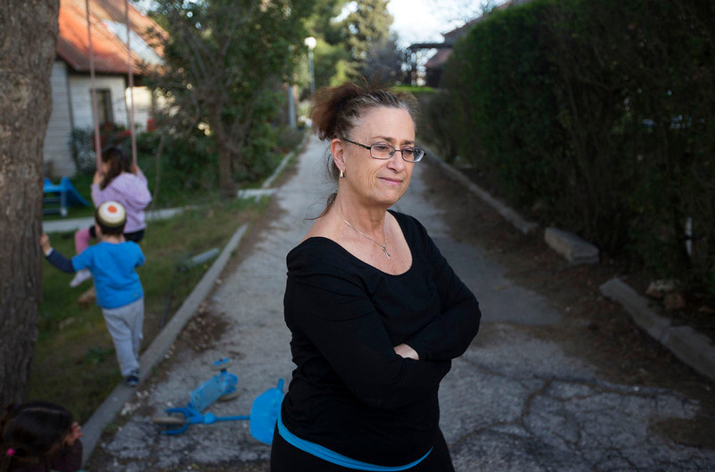 . Aliza Herbst, a yoga teacher and former settler spokeswoman stands outside her house in the West Bank Jewish settlement of Ofra, north of Ramallah on March 12, 2013. If there is one thing that seems to unite Israelis and Palestinians days before Obama\'s visit to Israel, the occupied West Bank and Jordan next week, it is their talk of broken promises and lack of hope that he will ever bring peace. Picture taken March 12, 2013. REUTERS/Ronen Zvulun