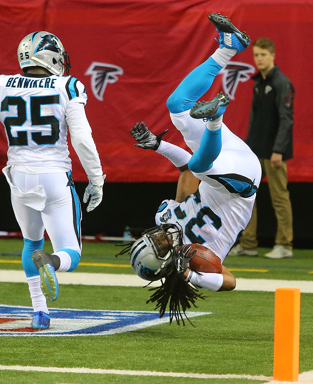 . Carolina Panthers safety (33) Tre Boston does a victory flip into the end zone after intercepting Atlanta Falcons quarterback Matt Ryan and returning the ball for a touchdown during the second half of an NFL football game Sunday, Dec. 28, 2014, in Atlanta. The Panthers won 34-3. (AP Photo/Atlanta Journal Constitution, Curtis Compton)
