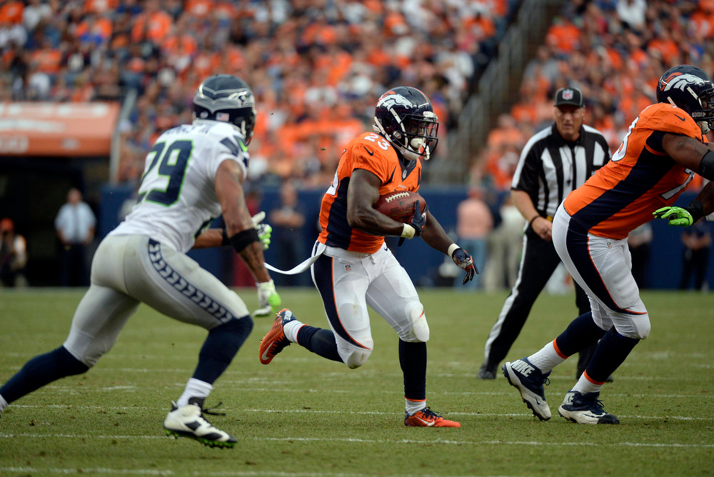 . Running back Ronnie Hillman (23) of the Denver Broncos carries the ball during the first quarter.  The Denver Broncos vs the Seattle Seahawks At Sports Authority Field at Mile High. (Photo by John Leyba/The Denver Post)
