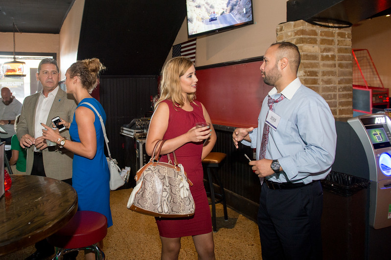Julie Surratt (center) receives information on the Young Business Professionals from YBP's past president, Joshua Tijerina. During the CCU40 Kick Off event in Corpus Christi, Tx.