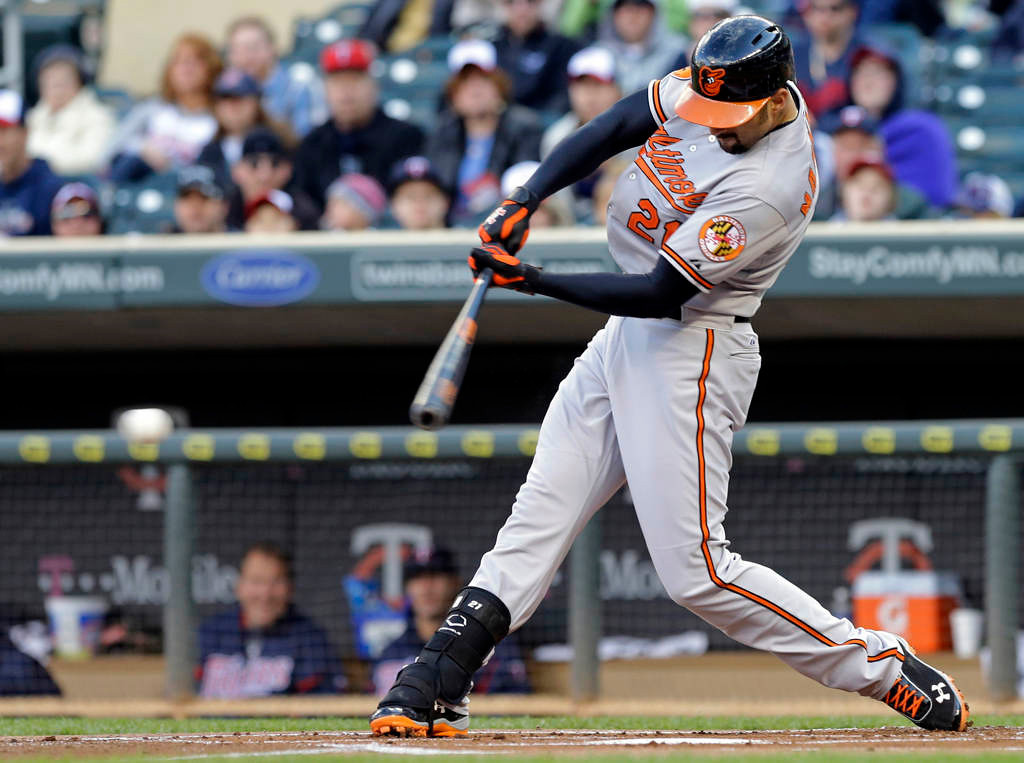 . Baltimore Orioles\' Nick Markakis drives in the first run of the baseball game with a single off Minnesota Twins pitcher Vance Worley in the first inning. (AP Photo/Jim Mone)