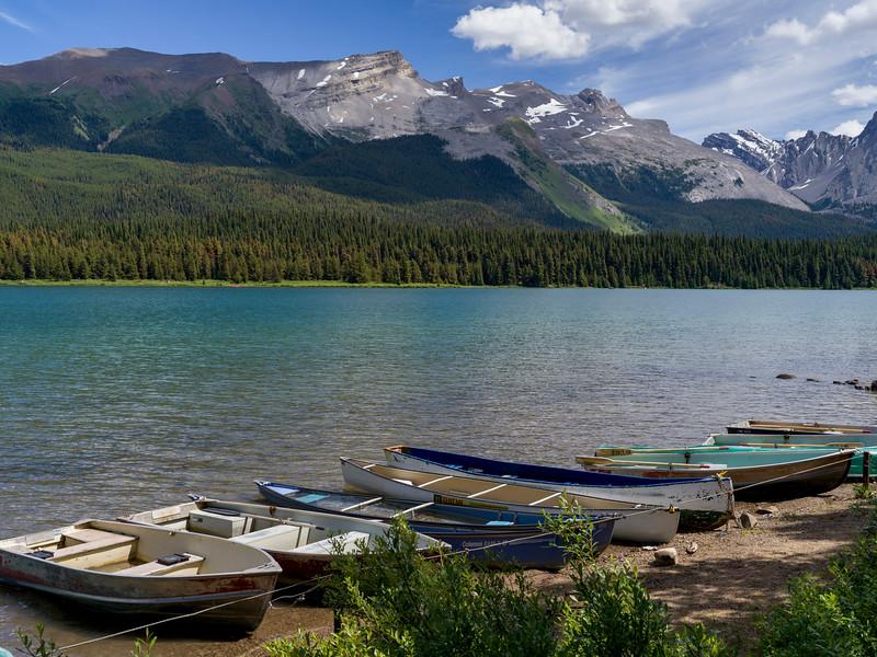 Boats at lakeside, Maligne Lake, Maligne Canyon, Jasper National Park, Jasper, Alberta, Canada