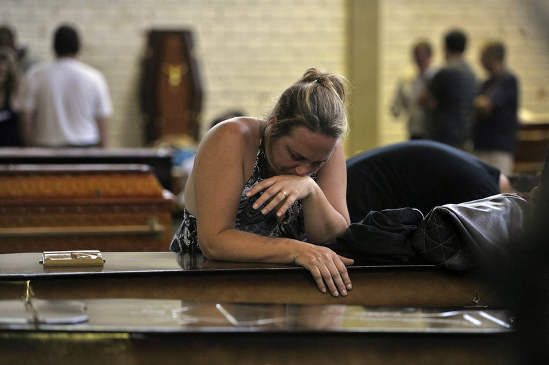 . The relative of a victim mourns over a coffin in Santa Maria, 550 Km from Porto Alegre, southern Brazil on January 27, 2013, after a fire at a nightclub killed more than 230 people. LAURO ALVES/AFP/Getty Images
