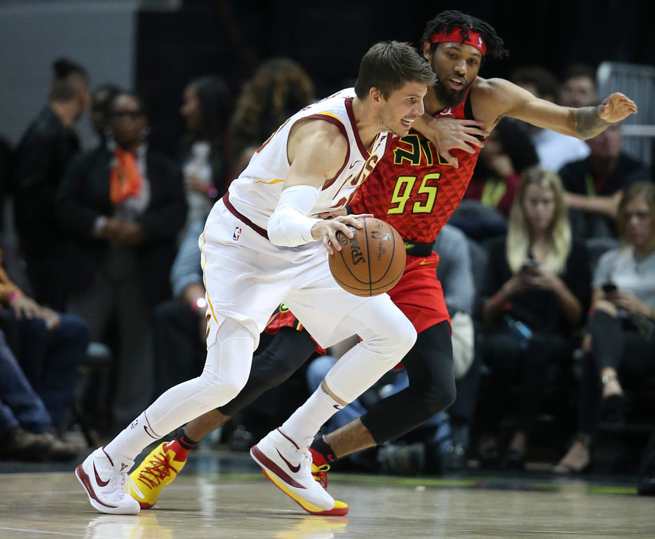 . Cleveland Cavaliers guard Kyle Korver (26) drives against Atlanta Hawks forward DeAndre\' Bembry (95) in the first half of an NBA basketball game Thursday, Nov. 30, 2017, in Atlanta. (AP Photo/John Bazemore)