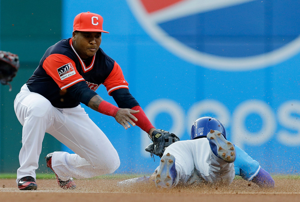 . Cleveland Indians\' Jose Ramirez is late on the tag to Kansas City Royals\' Whit Merrifield as Merrifield stole second base during the first inning of a baseball game, Friday, Aug. 25, 2017, in Cleveland. (AP Photo/Tony Dejak)