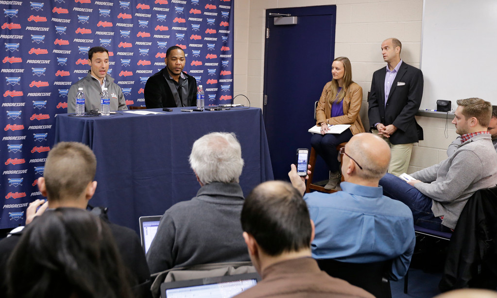 . Cleveland Indians president of baseball operations Chris Antonetti, left, and Cleveland Indians\' Edwin Encarnacion speak during a news conference, Thursday, Jan. 5, 2017, in Cleveland. One win from a World Series baseball title last season, the Indians finalized a $65 million, three-year contract with free agent slugger Encarnacion. (AP Photo/Tony Dejak)