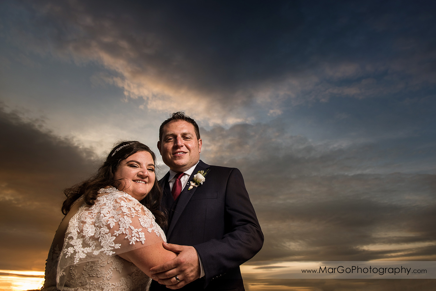 portrait of jewish bride and groom with sunset sky at Livermore Garre Vineyard and Winery