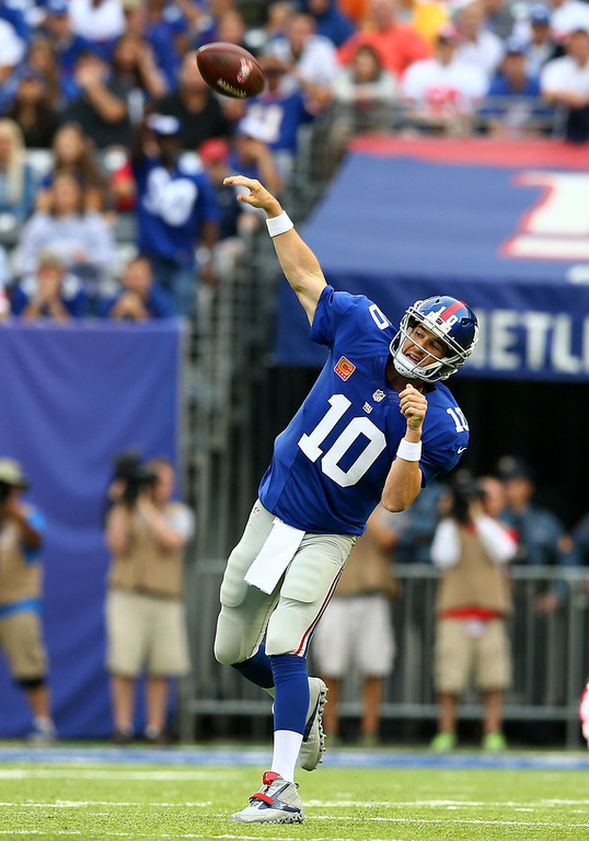 . Eli Manning #10 of the New York Giants throws an incomplete pass in the first quarter against the Philadelphia Eagles at MetLife Stadium on October 6, 2013 in East Rutherford, New Jersey.  (Photo by Elsa/Getty Images)