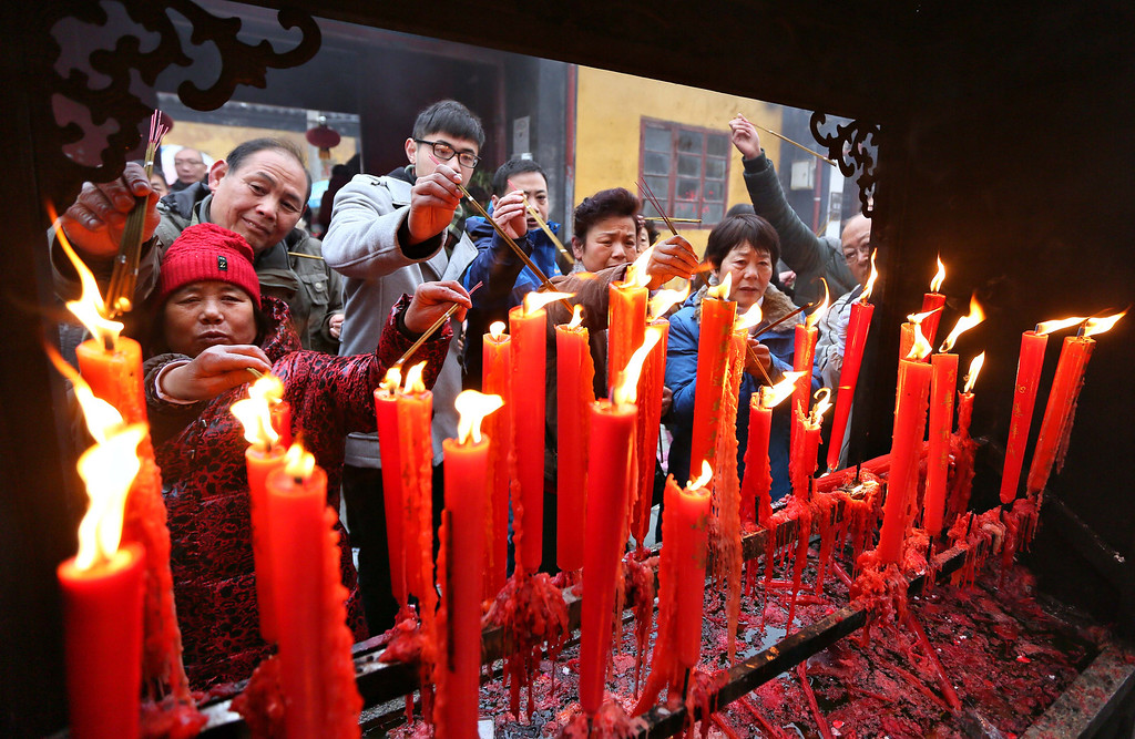 . People burn the incense and pray at a temple to welcome the Chinese New Year of the Horse on January 31, 2014 in Nantong, Jiangsu Province of China.  (Photo by ChinaFotoPress/Getty Images)