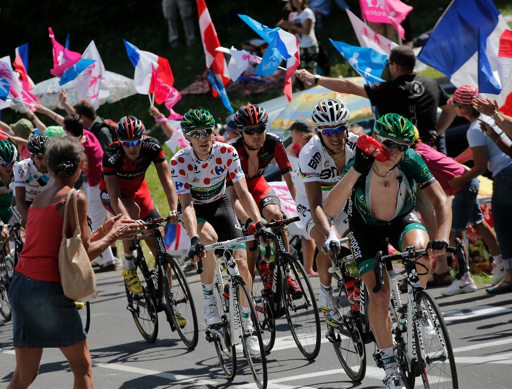 . Pierre Rolland of France, wearing the best climber\'s dotted jersey,Belgium\'s Philippe Gilbert, second right, and Tejay van Garderen of the U.S., third from right, climb during the 20th stage of the Tour de France cycling race over 125 kilometers (78.1 miles) with start in in Annecy and finish in Annecy-Semnoz, France, Saturday July 20 2013. (AP Photo/Christophe Ena)