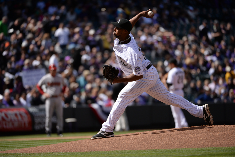 . Juan Nicasio pitches for the Rockies during the first inning. The Colorado Rockies hosted the Arizona Diamondbacks in the Rockies season home opener at Coors Field in Denver, Colorado Friday, April 4, 2014. (Photo by Hyoung Chang/The Denver Post)