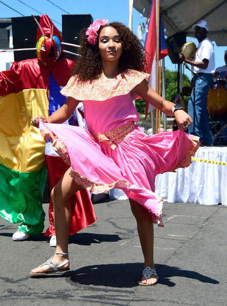 7/21/2018 Mike Orazzi | Staff Keyla Diaz performs during the annual  Puerto Rican Festival held on High Street in New Britain Saturday.
