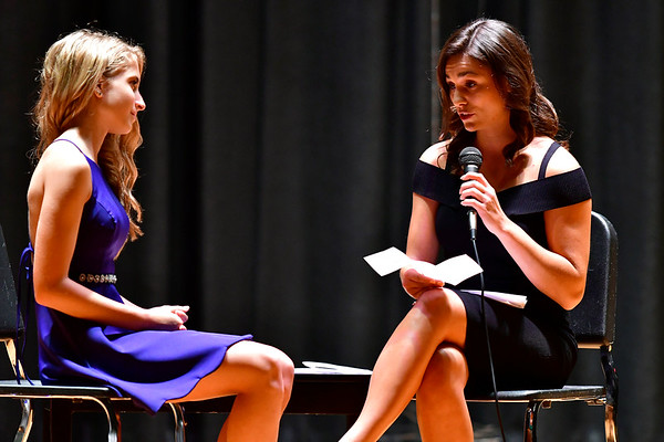 9/14/2018 Mike Orazzi | Staff Taylor DiChello interviews Jenna Siemiatkoski during the Miss Mum pageant Friday night at the Chippens Hill Middle School.