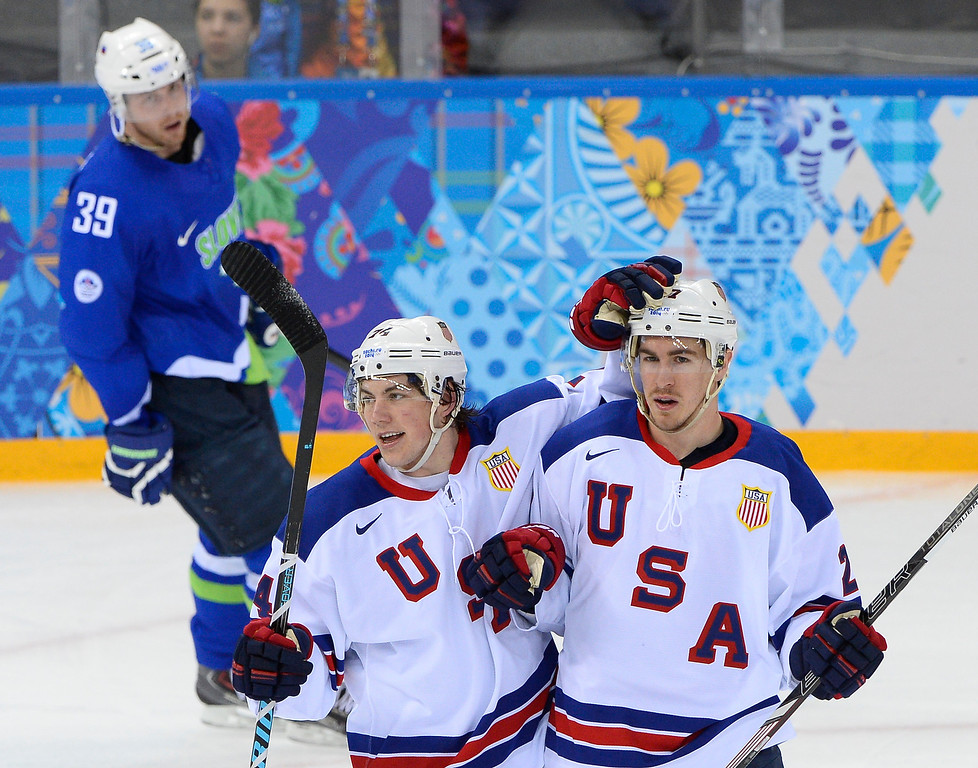. US Ryan Mcdonagh (R) celebrates with his teammate TJ Oshie after scoring a goal during the Men\'s Ice Hockey Group A match between Slovenia and USA at the Shayba Arena during the Sochi Winter Olympics on February 16, 2014. JONATHAN NACKSTRAND/AFP/Getty Images