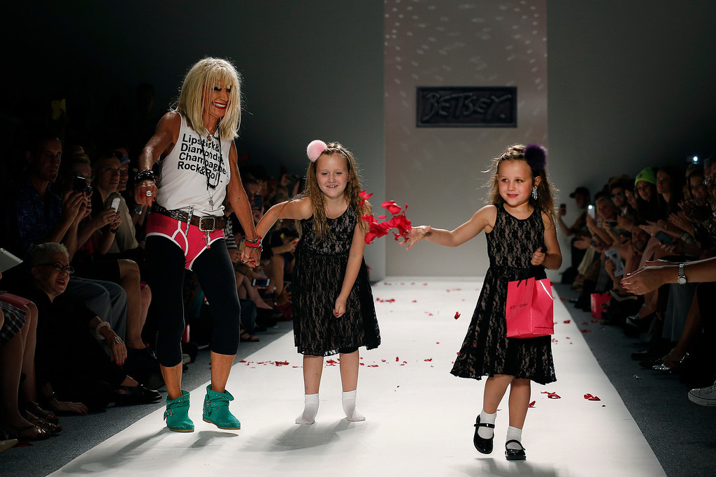 . Designer Betsey Johnson and her gradndaughters Layla, center, and Ella, right, walk the runway after the Betsey Johnson Spring 2014 collection was modeled during Fashion Week in New York, Wednesday, Sept. 11, 2013. (AP Photo/John Minchillo)