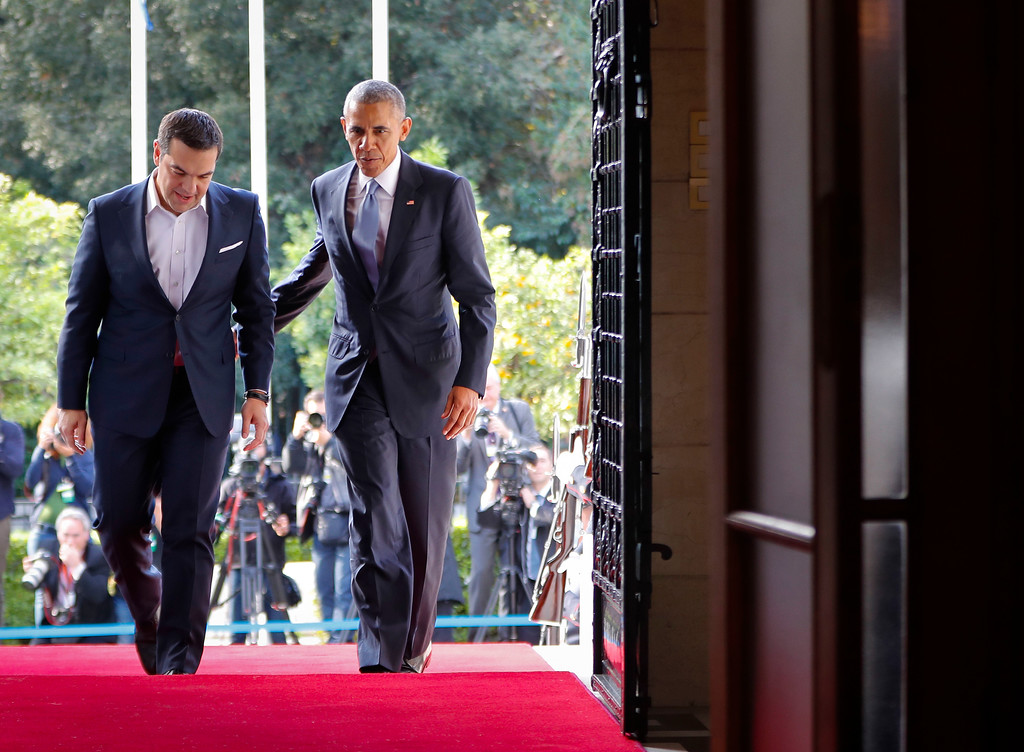 . US President Barack Obama walks into the Maximos Mansion with Greek Prime Minister Alexis Tsipras to begin their joint meeting and news conference in Athens, Tuesday, Nov. 15, 2016. (AP Photo/Pablo Martinez Monsivais)