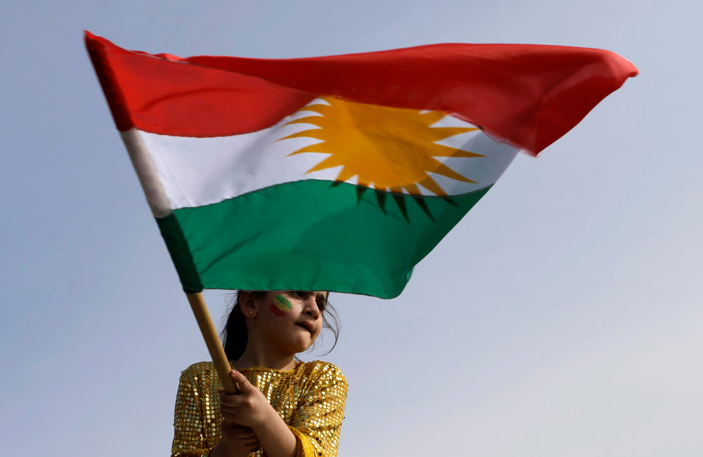 . A Kurdish girl who lives in Lebanon waves the Kurdish flag during the celebration of Nowruz in Beirut, Lebanon, Thursday, March 21, 2013.  Nowruz, the Farsi-language word for \'new year\', is an ancient Persian festival, celebrated on the first day of spring in central Asian Republics, Afghanistan, Iran, Iraq and Turkey. (AP Photo/Hussein Malla)