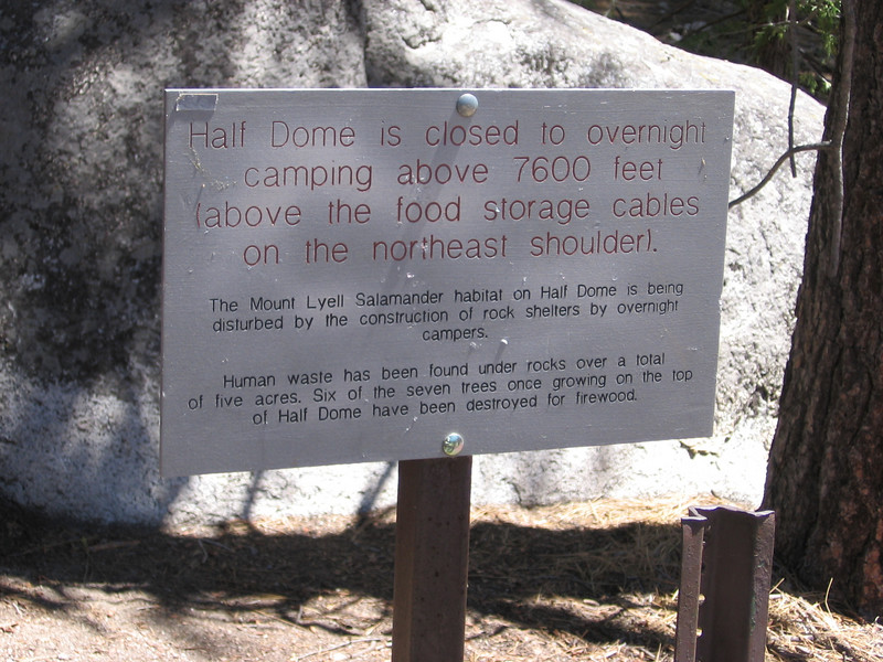 """Park Service sign. I camped on top of Half Dome in the 1970's on a crystal-clear night when there was a very deep lunar eclipse - very cool! Wouldn't want to be up there if the weather was unsettled, though. Places like Half Dome argue for a """"rating"""" system where, if you can document a certain level of experience and savvy and passed a written and practical test, you would be allowed to camp where others without the rating could not."""