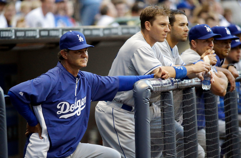 . Los Angeles Dodgers manager Don Mattingly watches from the dugout during the first inning of a baseball game against the Milwaukee Brewers Tuesday, May 21, 2013, in Milwaukee. (AP Photo/Morry Gash)