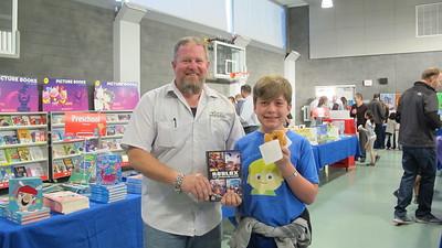 Dads, Doughnuts, Books Make for a Fun PCY Event