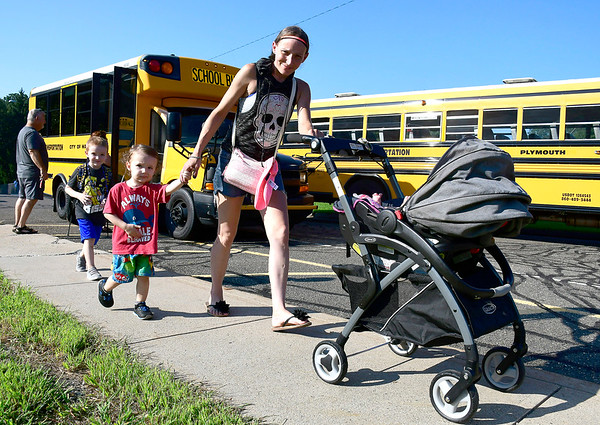 8/29/2018 Mike Orazzi | Staff Kimberly Palmieri arrives with her son Daniel Ames (left) for his first day of kindergarten along with her other children Tyler and Alexis for the first day of school at the Fisher Middle School in Plymouth Wednesday morning.