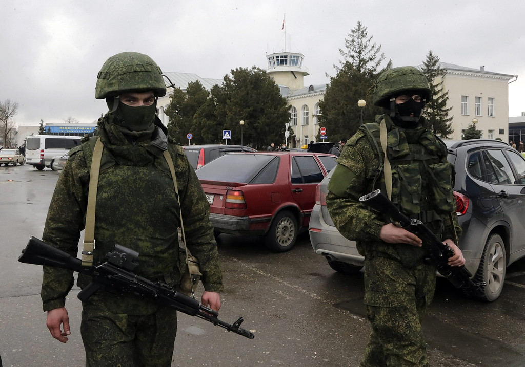 . Unidentified armed men in military uniform patrol near a building of the airport in Simferopol, Crimea, Ukraine, 28 February 2014. A group of armed men seized the airport of Simferopol - the peninsula\'s capital city - in the early hours of Friday. Around 50 armed men in military uniform arrived in three trucks without licence plates, surrounding the domestic flights terminal before moving onto other parts of the airport, the Interfax-Ukraine news agency reported. The armed men, described by Interior Minister Arsen Avakov as Russian naval forces, also took control of a military airport near the port of Sevastapol where the Russian Black Sea Fleet has a base. Russia denied the accusations, saying that it had not deployed troops nor had any role in blockading the airport. Fears of a conflict in Crimea have intensified after Ukraine accused Russia of occupying two airports on the southern Ukrainian peninsula.  EPA/MAXIM SHIPENKOV