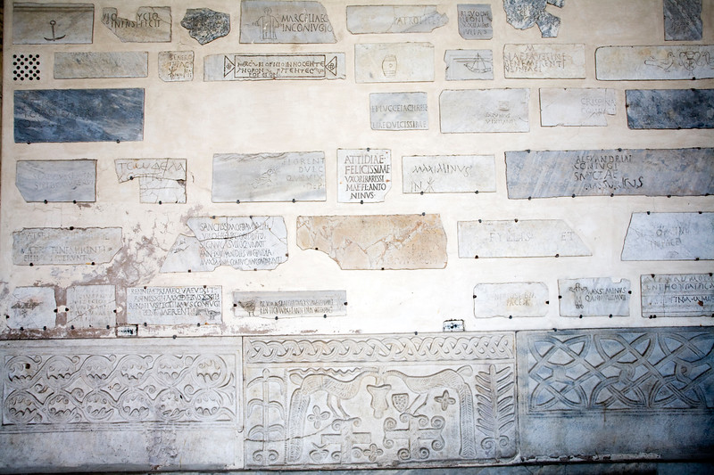 Fragments from the ancient catacombs in the narthex of Santa Maria in Trastevere basilica, Rome