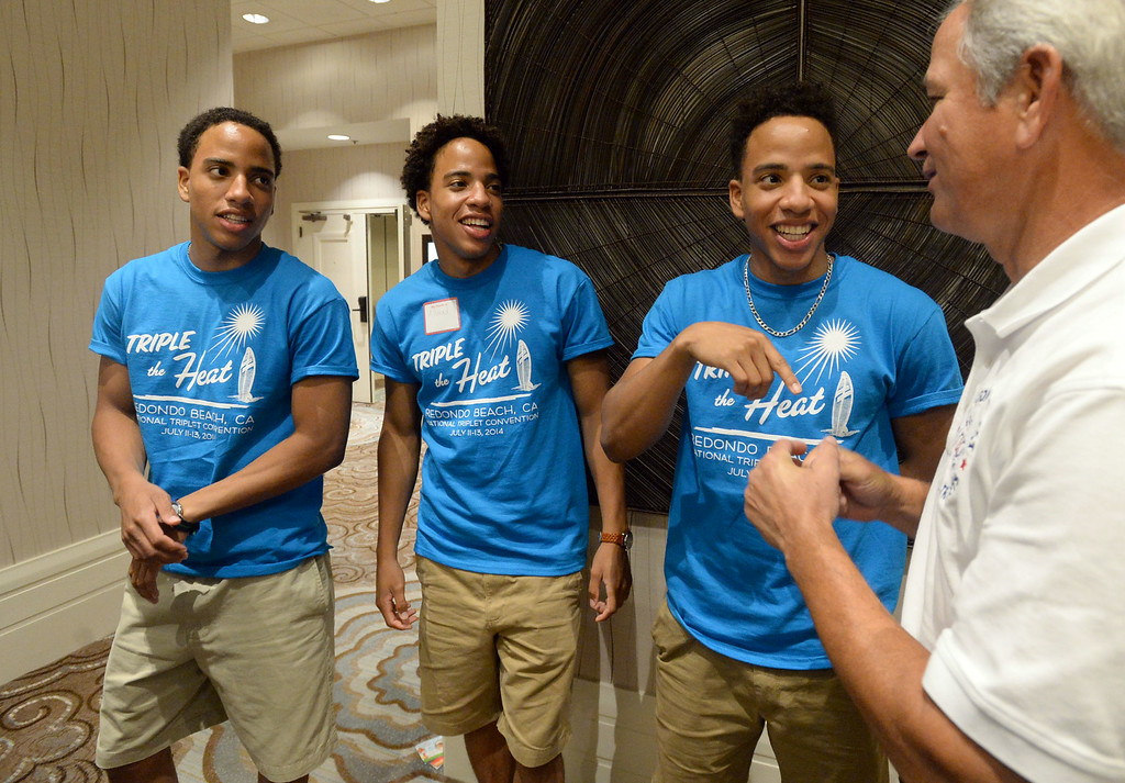 . Triplets from around the globe converged at the Crowne Plaza Hotel for the National Triplet Convention Saturday, July 12, 2014, Redondo Beach, CA  From left: Malik, Ahmad and Khalil Jones, 18, from Washington DC, talk with fellow triplet Gerry Kosanovic, right. Photo by Steve McCrank/Daily Breeze