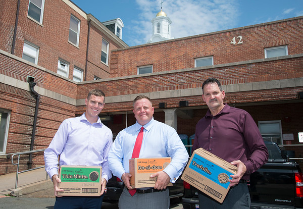 08/14/19 Wesley Bunnell | Staff Congressional candidate John Cain, senate candidate Robert F Hyde and congressional candidate Justin Anderson stand in rear of the Newington VA on Wednesday August 14, 2019 after deliver over three thousand boxes of donated Girl Scout cookies to their fellow veterans.