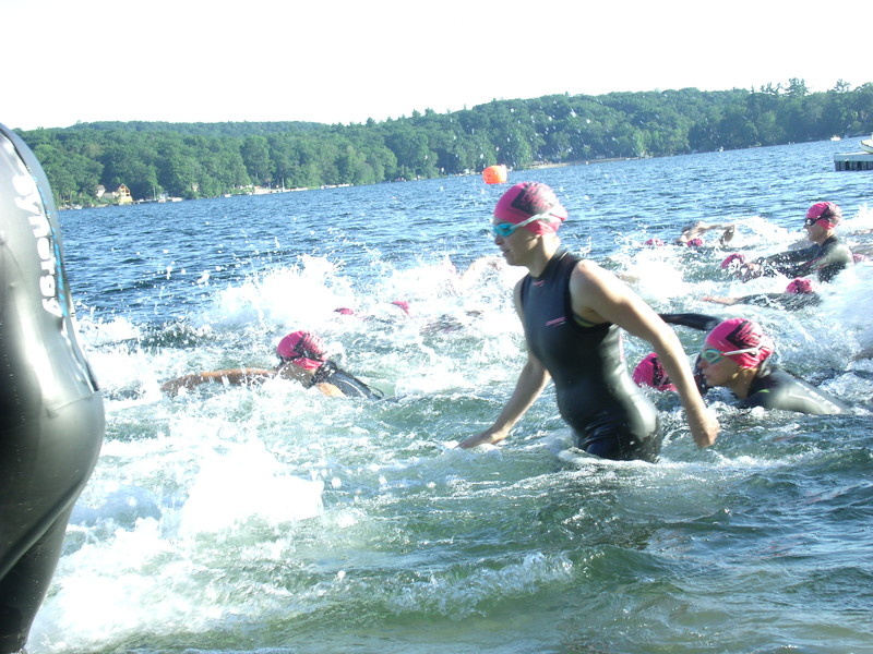 TRIATHALON - Swimmers entering the water on a bright warm day to kick off the triathalon.JPG